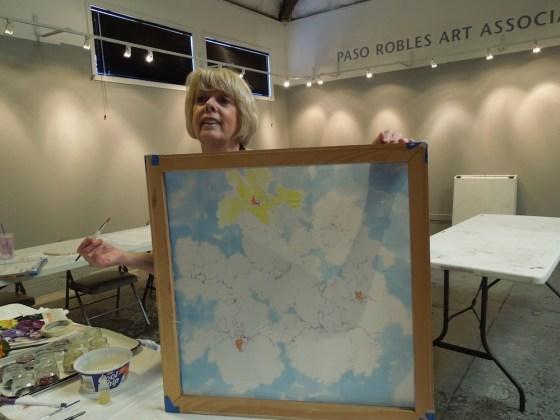 Liv Hansen demonstrates painting on silk in PRAA Classroom at Studios on the Park