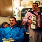 Senior Connor Carollo listened as the choir was serenaded by an accordion player at a restaurant in Venice. Photo by Molly Howland.