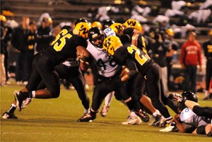 Kyle Ball fights through the line to get to the ball carrier.
