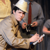 Senior Max Hofmeister plays a reporter and is in the chorus