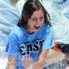 Carey Schafer laughs as she is splashed with soapy water. Photo by Marisa Walton