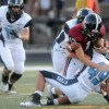 Senior Luis Adame and Junior Sam Pottenger sack the Lawrence High quarterback, Nyle Anderson. Photo by Marisa Walton