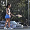Junior Grace Stanziola preps for her serve. Photo by Abby Hans