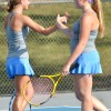 Sophomore Abby Hans and her partner Senior Ellie Waugh hi-five after scoring a point against Barstow. Photo by Kylie Rellihan