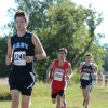 Sophomore John Rogers races to the front of his competition. Photo by Neely Atha