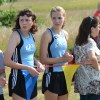 Sophomore Tess Iler watches as the Junior Varsity boys finish. Photo by Neely Atha