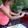 Junior Annie Savage works on creating suitcases to put on the float.  Photo by Meghan Shirling