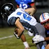 Running back and junior Sam Huffman is taken down by Olathe North defense after a short run. Photo by Marisa Walton