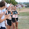 A group of C-team runners wait to cheer on other runners. Photo by Neely Atha