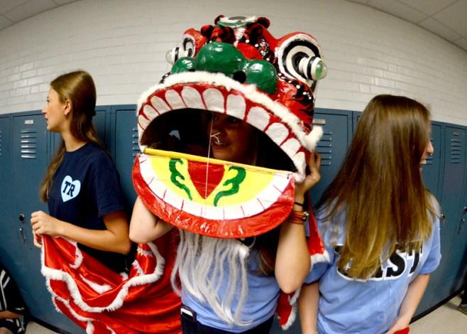 Chinese club wears a dragon head. Photo by Kathryn Jones