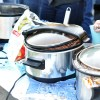 Dozens of crock-pots were lined up for tasting and voting of who had the best chili.  Photo by AnnaMarie Oakley