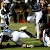 Senior Ryan Carter misses a tackle after junior Sam Williams missed the same North ball carrier. Photo by Hailey Hughes