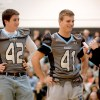 Senior Pep Club member Ashley Murrell asks football captain Mitchell Tyler questions during the pep rally. Photo by Marisa Walton