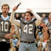 Senior football captains Christian Blessen, Ryan Carter, and Mitchell Tyler get the crowd cheering during the pep rally. Photo by Marisa Walton