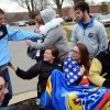 Senior Maddie Hise, Lily Fritz,  and Faith Conlley greet their friends who came home from college.  Photo by Meghan Shirling