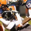 The Olathe East defense wraps up a Lancer running back in the first half. Photo by Marisa Walton