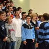 Mr. Foley keeps the choir energized as he directs them. Photo by Annika Sink