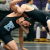 Sophomore Mike Bamford escapes a headlock from BVNW wrestler. By Katie Lamar