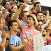 Senior Jay Anderson gets the student section going during the game. Photo by Mckenzie Swanson