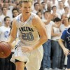 Senior Colin Burns drives in for a basket. Photo by Marisa Walton