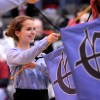 Junior Emily Biegelsen and the other SME Heralders participate in their opening ceremonies before the game. Photo by Marisa Walton