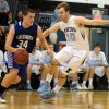 Senior Christian Blessen guards a Pioneer player going in for a layup. Photo by Marisa Walton