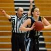 Senior Emiy Dodd looks for open teammates as she prepares to throw the ball inbounds. Photo by Tessa Polaschek