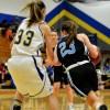 Senior Erin McGinley pushes around an opponent to take a shot. Photo by Tessa Polaschek