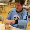 Junior Michael Mardikes eagerly cuts his pancakes. Photo by Katie Lamar