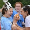 Ava Backer screams as the soap drips down from Libby Fryes sponge. Photo by Annika Sink