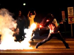 ferguson-rioter-tear-gas-AP