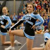 Sophomore cheerleader Andrea Nordby hits the final pose of the cheer routine. Photo by Julia Poe