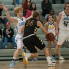 Senior Jack Flint shuffles to stay in front of West's sophomore Zach Witters. Photo by James Wooldridge