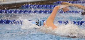 Sophomore Bennet Hense approaches the wall during the 400 yard Freestyle Relay. Photo by Annie Lomshek.