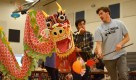 Lars Troutwine and Alex Bulbarela communicate during the dragon dance performed by the Chinese students. Photo by Annie Lomshek.