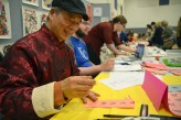 Calligrapher vendors create bookmarks to sell at the Cabaret. Photo by Annie Lomshek.