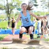 Freshman Peyton Hassenflu lands her long jump. Photo by Morgan Browning