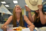 Senior Shelby Harvey takes Bubzowskis' festive cowgirl hat. Photo by Annie Lomshek.