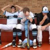 Seniors Charley White, Max Byers and junior Matthew Erdner sit in disappointment on the bench after the game. Photo by Joseph Cline