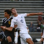 Senior Luke Ehly goes after a header against a SMW player. Photo by Annie Lomshek.