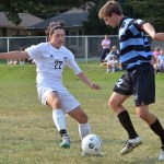 Senior Liam Griffin and Junior Jackson Pritchard fight for control of the ball. Photo by Abby Blake