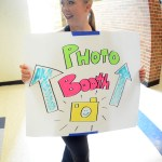 Junior Bailey Riecker advertises for the photo booth outside the gym. Photo by Kaitlyn Stratman