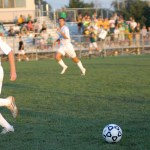 Junior Tommy Kerr defends the ball.  Photo by Tess Iler