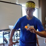 Sophomore Charlie Moreland balances a pingpong ball on an spoon during a relay race.
