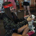 Freshman Megan Walstrom tapes together a purse for a newspaper fashion show.