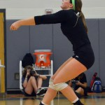 Junior Emma Henderson bumps the ball to another player. Photo by Abby Blake