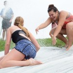 Senior Emma Olander pushes Senior Hannah Eldred down the slide. Photo by Morgan Browning
