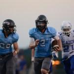 Junior quarterback Luke Kaiser breaks free for a 30-yard run making it his second touchdown of the night. Photo by Joseph Cline