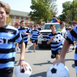 The Boys' Soccer team sprints into the Prairie Village Shops at the end of the parade. Photo by Morgan Browning