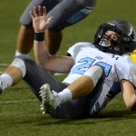 Senior Rider Terry falls on the ground after a tackle. Photo by Kaitlyn Stratman